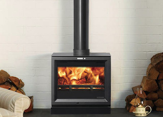 a wood burner with a nice glowing flame free standing in a room